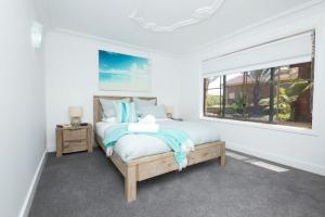 A bed or beds in a room at SAND DUNES