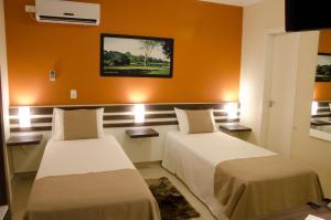 A bed or beds in a room at Bristol Portal do Iguaçu Hotel