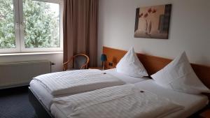 瓦爾茨酒店房間的床