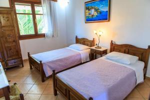 Ένα ή περισσότερα κρεβάτια σε δωμάτιο στο Anatoli Villa