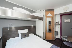 A bed or beds in a room at Cabinn Scandinavia