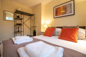 A bed or beds in a room at Valentia Headington Oxford Keyworker Accommodation