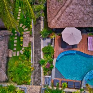 A view of the pool at Village Vibes Lombok or nearby