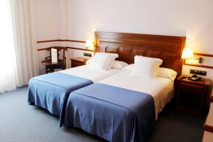 A bed or beds in a room at Checkin Antequera