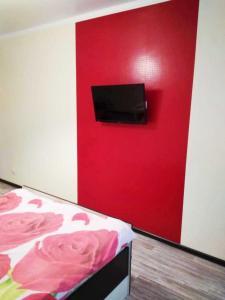 A television and/or entertainment center at Centr goroda Shorsa 8M