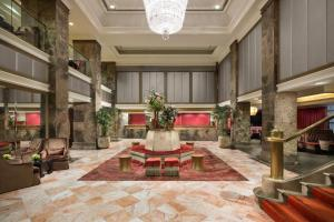 The lobby or reception area at Michelangelo Hotel