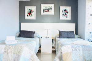 Cama o camas de una habitación en Resitur 709