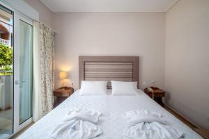 A bed or beds in a room at Anamar Zante Hotel