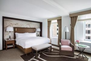 A bed or beds in a room at The Ritz-Carlton New York, Central Park