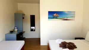 A television and/or entertainment center at Positano Alona Beach Panglao