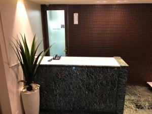 A bathroom at Prime Hotel Fulula (Adult Only)