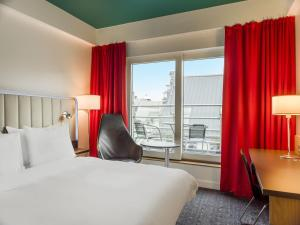 A bed or beds in a room at Park Inn by Radisson Oslo