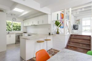 A kitchen or kitchenette at At Agnes Ave: coastal views