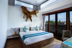 A bed or beds in a room at The Samara Villas & Restaurant