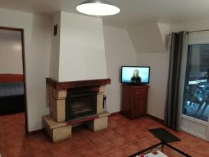 A television and/or entertainment center at Vintage Apartment In Quend-Plage-les-Pins with Swimming Pool