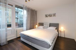 Een bed of bedden in een kamer bij 32 De Overtoom