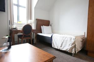 En eller flere senge i et værelse på Best Western Hotel Hebron