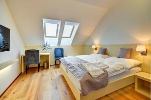 Postel nebo postele na pokoji v ubytování hotel Chmelnice