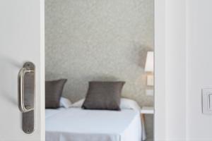 En eller flere senge i et værelse på Mirador Maspalomas by Dunas