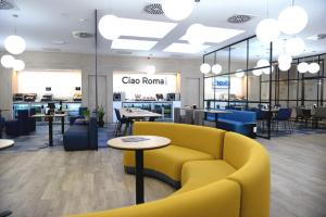 The lounge or bar area at Air Rooms Rome Airport by HelloSky