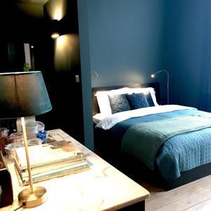 Een bed of bedden in een kamer bij Bacchus Antwerpen