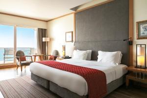 Cama o camas de una habitación en Sesimbra Hotel & Spa