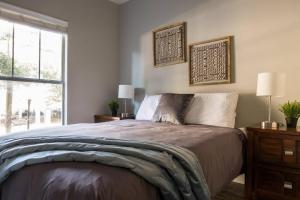 A bed or beds in a room at Quiet + Modern | Parking | Dining + Shopping 2BR