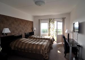 Säng eller sängar i ett rum på Källan Hotell Spa Konferens