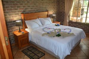 A bed or beds in a room at Thaba Tsweni Lodge & Safaris