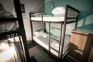 A bunk bed or bunk beds in a room at Vibrant Hostel