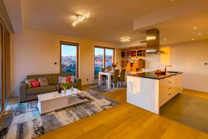 A kitchen or kitchenette at Bel Etage Amora Luxury Seaview Apartment with pool