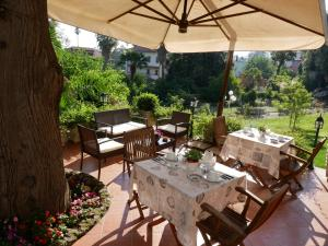 A restaurant or other place to eat at B&B du Parc Boutique Home