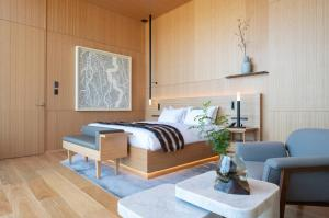 A bed or beds in a room at Skye Niseko