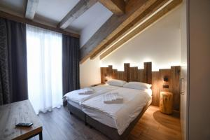 A bed or beds in a room at Residence & Wellness 3MILA