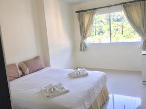 Кровать или кровати в номере Royal Kamala Phuket