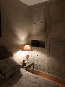 A bed or beds in a room at duplex/jardin Deauville centre