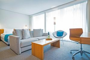 A seating area at Lindner Hotel AM KU'DAMM Berlin