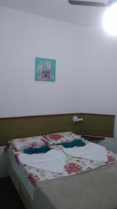 A bed or beds in a room at Solaris do Atlantico