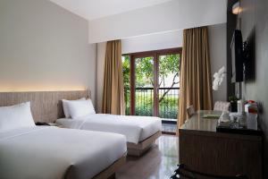 Кровать или кровати в номере Hotel Santika Siligita Nusa Dua