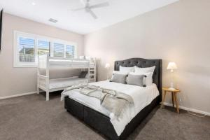 A bed or beds in a room at The Hampton's in Blairgowrie