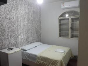A bed or beds in a room at Araca Hotel