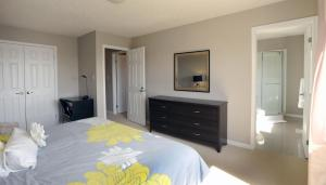 A bed or beds in a room at Boardwalk Homes Vacation & Bridal Guest Houses