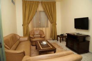 A seating area at Safari Hotel Apartments - BAITHANS