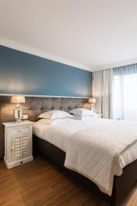 Ein Bett oder Betten in einem Zimmer der Unterkunft C-Hotels Cocoon