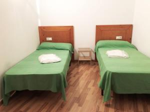 A bed or beds in a room at Apartamentos La Solana 3000