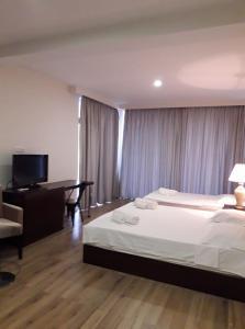 Кровать или кровати в номере Belgrade Rustaveli Hotel