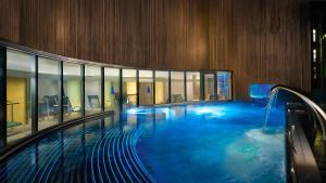 The swimming pool at or near Sheraton Grand Hotel & Spa