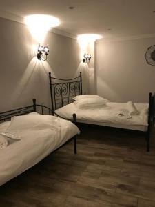 Cama ou camas em um quarto em Studio Max