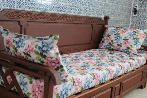 A bed or beds in a room at City Apartment Mahdia free wifi