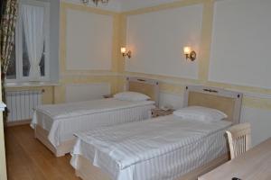 Кровать или кровати в номере Отель Ильмень
